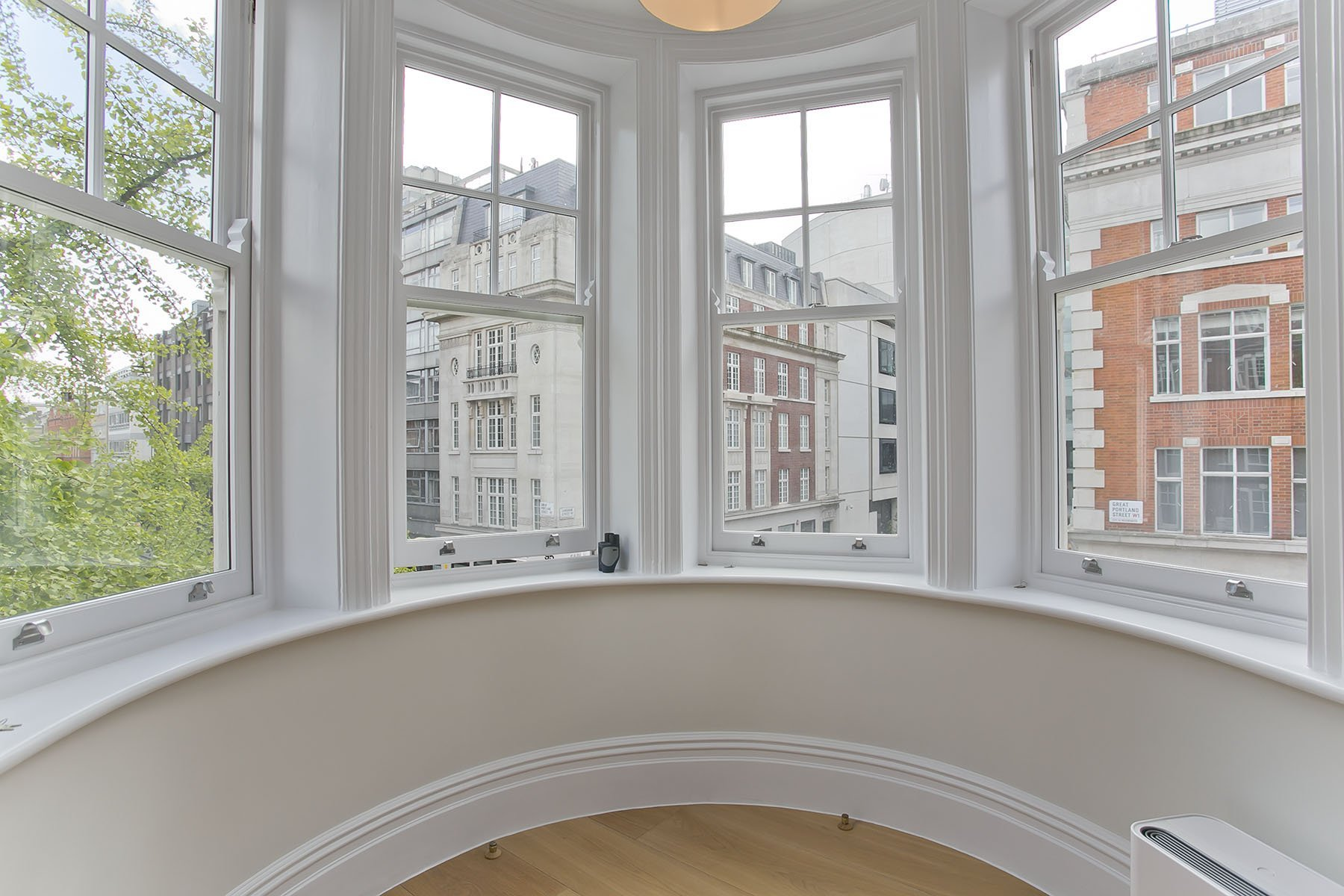 painting service in Marylebone with white painted walls and bay window