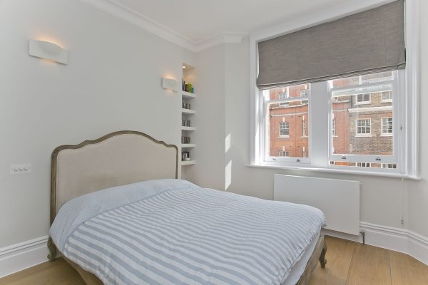 Painting And Decorating Services For A Bedroomwith Walls Painted In Dulux Trade Diamond Matt 00NN 83/000, Woodwork And Ceiling Painted In Dulux Trade Diamond Matt Brilliant White , Open And Closed Storage And Comfy Bed