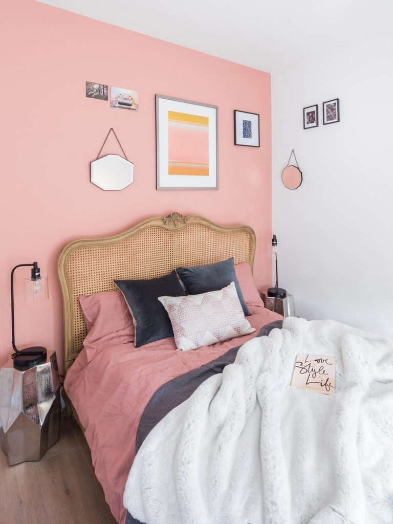 painting and decorating services for bright bedroom with pink and white painted walls, designers furniture, London