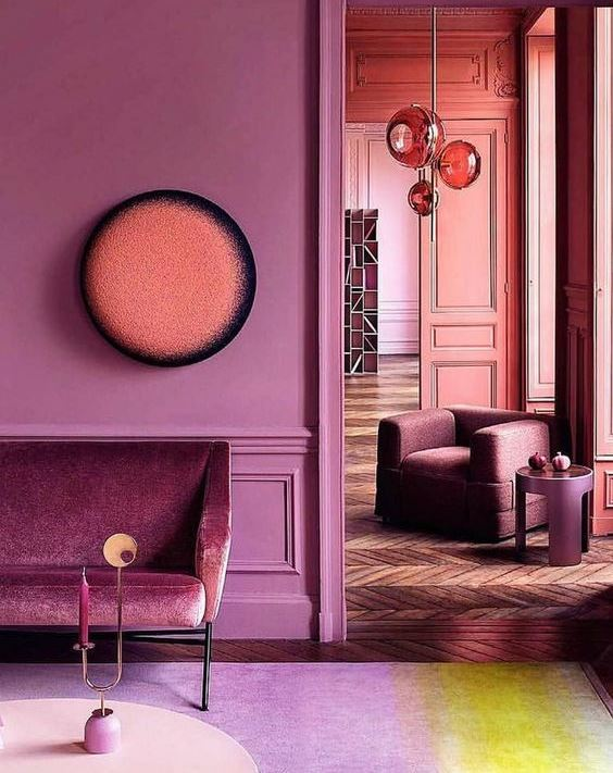 painting service for a bright room with purple painted walls, purple sofa and armchair, purple coffee table and purple carpet