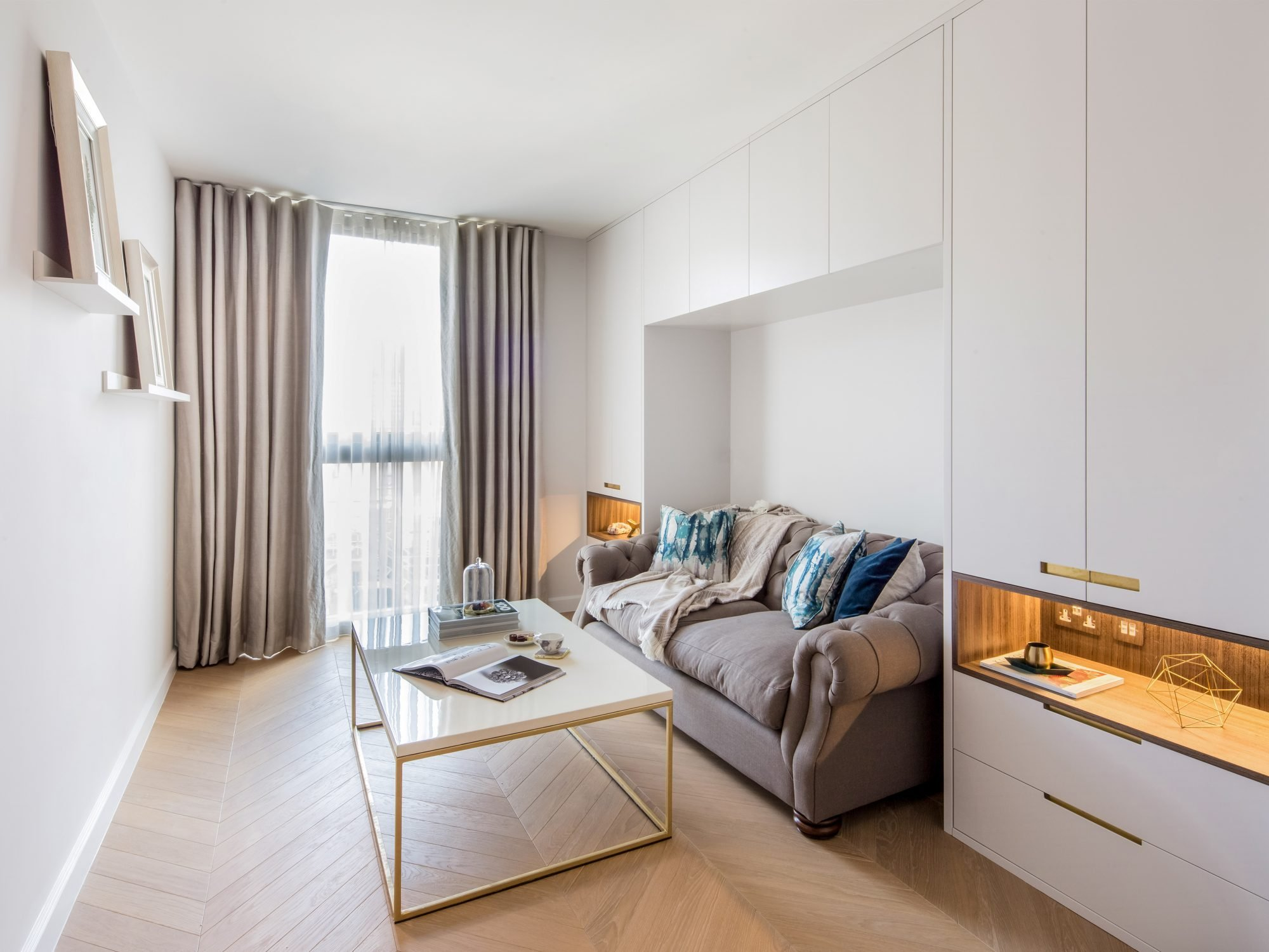 residential painting and decorating services for light living room with walls and ceiling painted white, designer furniture in Westminster, London