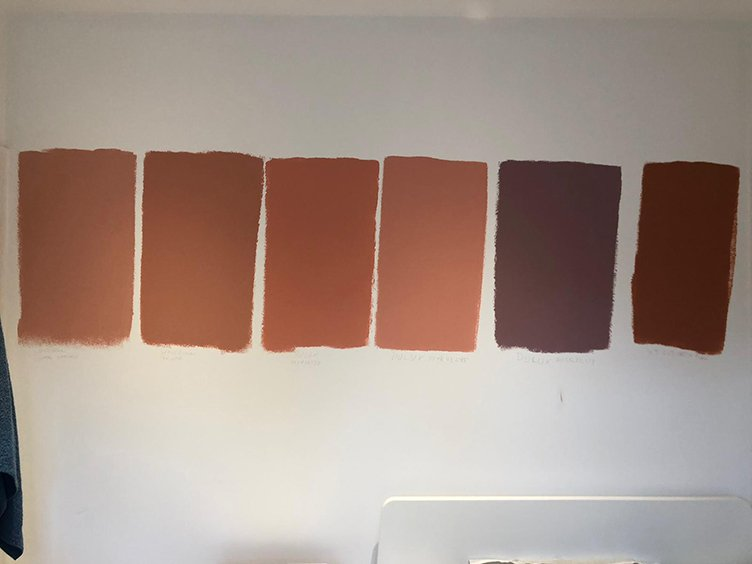 Colour samples for the master bedroom painted on the wall