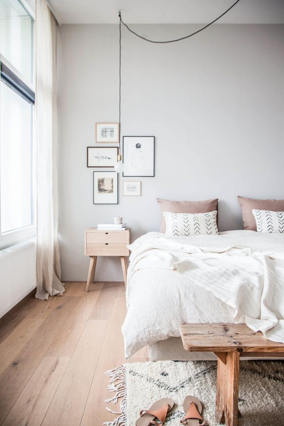 residential painting and decorating for light scandinavian bedroom with white painted walls and ceiling