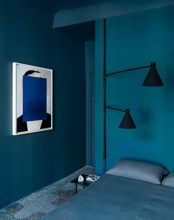 residential painting and decorating services for bright blue bedroom with walls and ceiling painted blue, blue carpet, blue bed, London