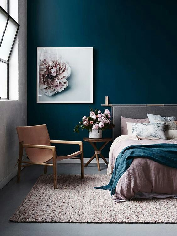 residential painting and decorating for spacious bedroom wih walls painted white and dark blue