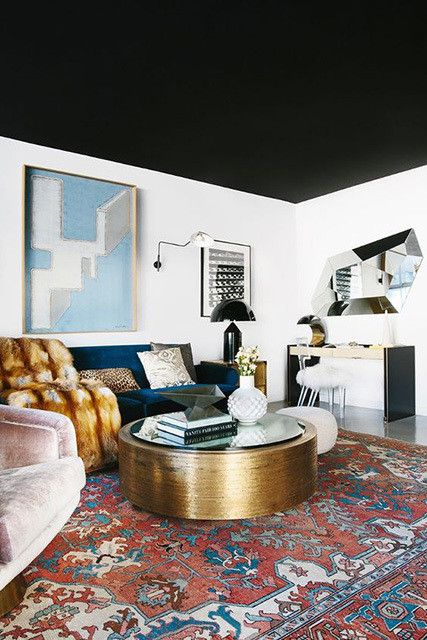 residential painting and decorating for spacious living room with black painted ceiling, London