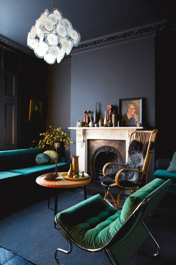 residential painting and decorating services for dark painted living room with green velvet furniure