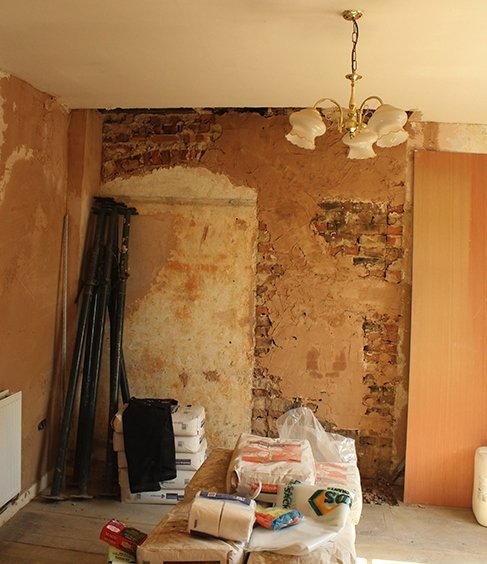 Before: Living room area required plastering and painting