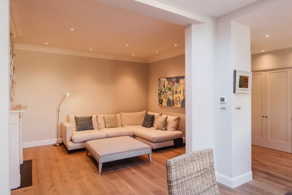 Residential Painting And Decorating Service For Cosy Sitting Room With Walls Painted In Slipper Satin, Woodwork And Ceiling In All White From Farrow And Ball