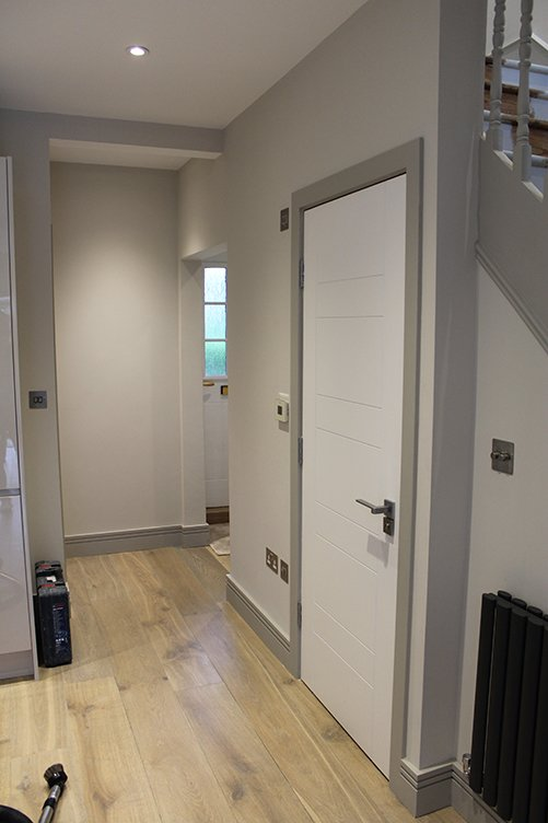 residential painting and decorating services for light Painted corridor. Walls painted in Dulux Trade 00NN 83/000, skirtings and architraves painted in 00NN 53/000