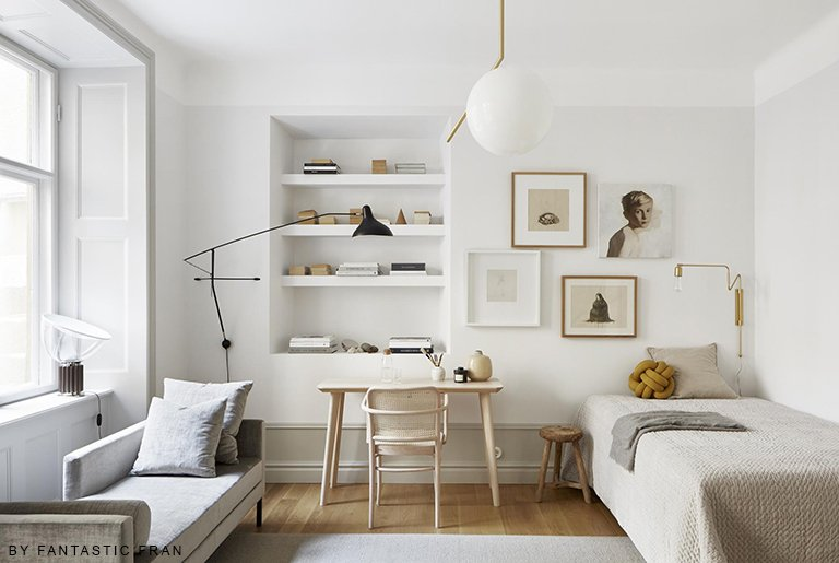 residential painting and decorating for light bedroom in scandinavian interior style with white painted walls and ceiling, wooden furniture