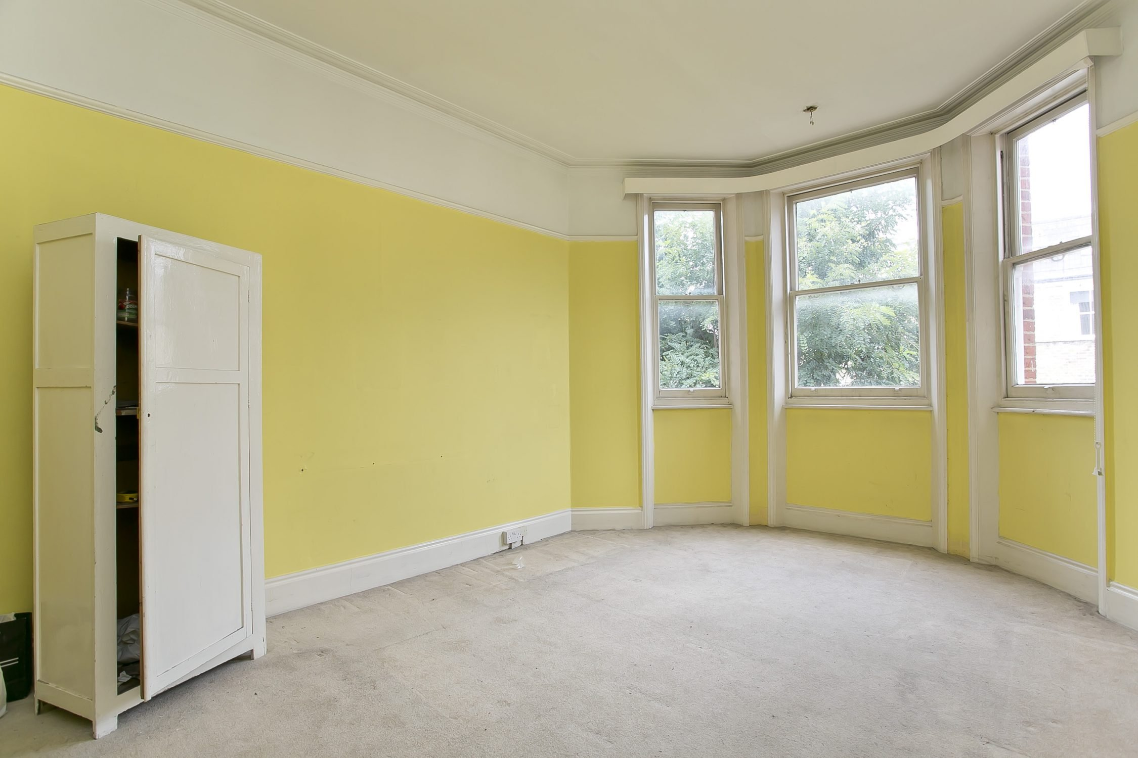 master bedroom before; yellow painted walls