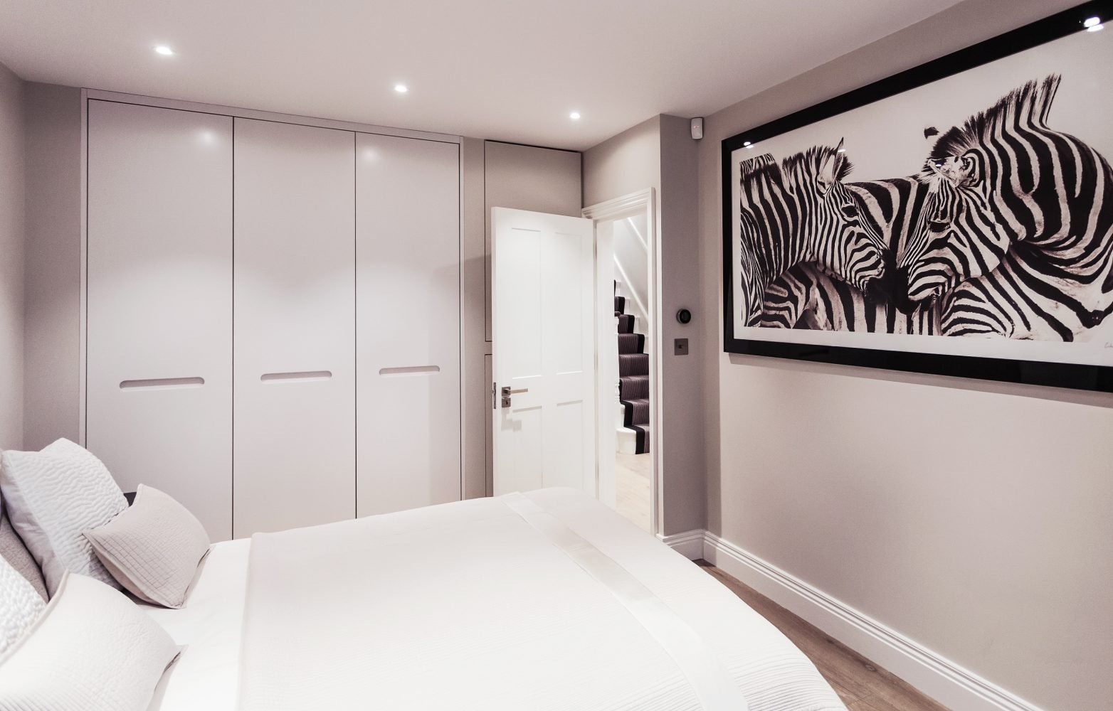 Painting And Decorating A Four Storey Family House In Chelsea, London- Light Master Bedroom With White Painted Walls And Ceiling And White Storage