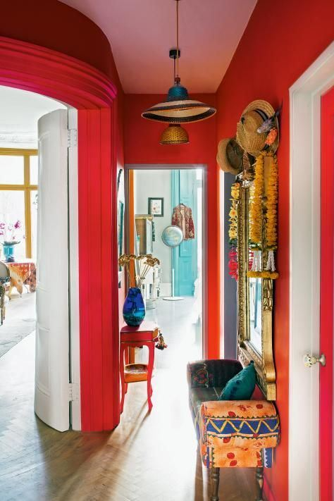 painting service for a bright hallway with red painted walls and whimsical furniture