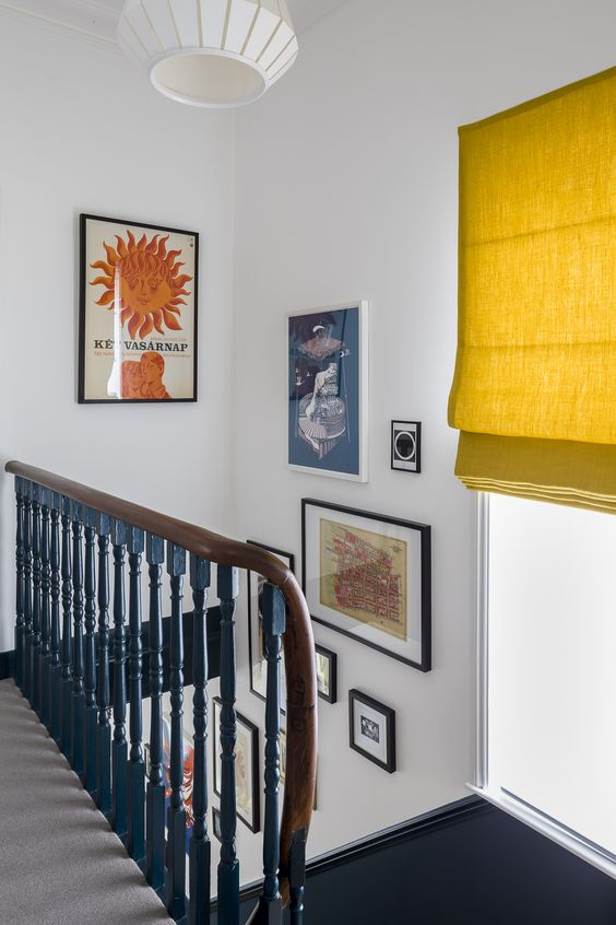 residential painting and decorating for hallway with walls painted white, staircase with blue baluster, London