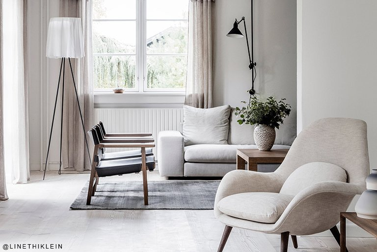 residental painting and decorating for light scandinavian living rooom with white painted walls and ceiling, comfy furniture
