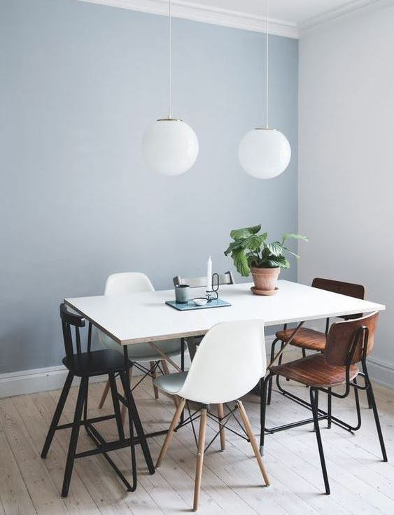 painting service for dining area with light blue walls, white, black and brown furniture