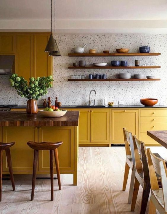 residential painting services for kitchen with yellow painted cabinets and wooden furniture
