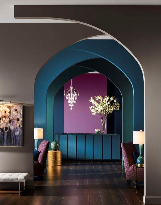 playful and colourful room with bright interior: grey, blue, pink, green painted walls