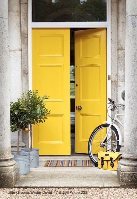 yellow painted front door in London