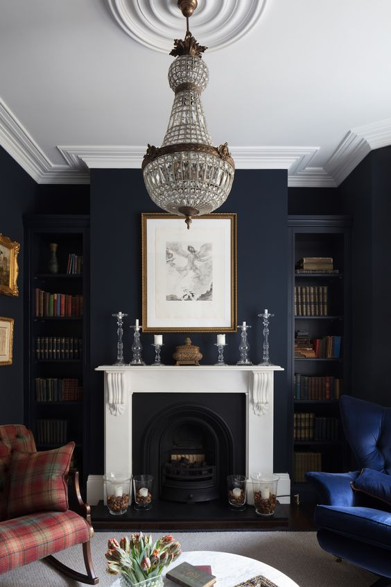 residental painting service for bright living room with white painted ceiling, dark navi painted walls, black and white fireplace