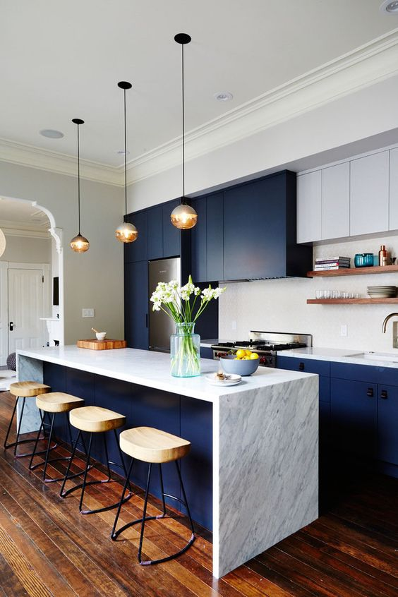 playful colourful interior design for spacious kitchen with dark navi cabinets, white walls and ceiling, high chairs