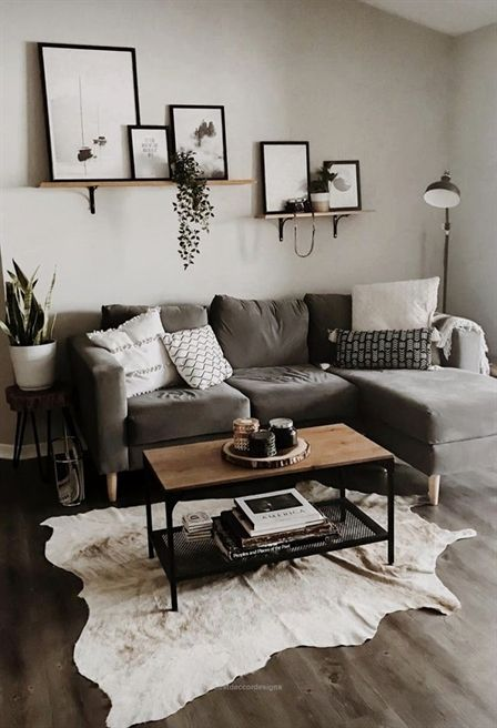 residential painting service for light living room painted grey with grey sofa, coffee table, light rug