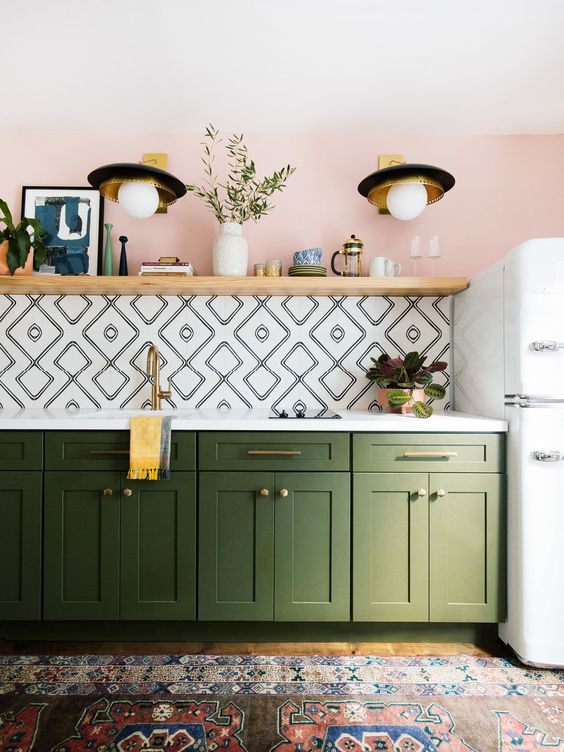 playful kitchen with walls painted pink, green painted cabinets