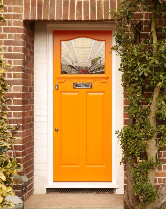 london house-orange painted front door