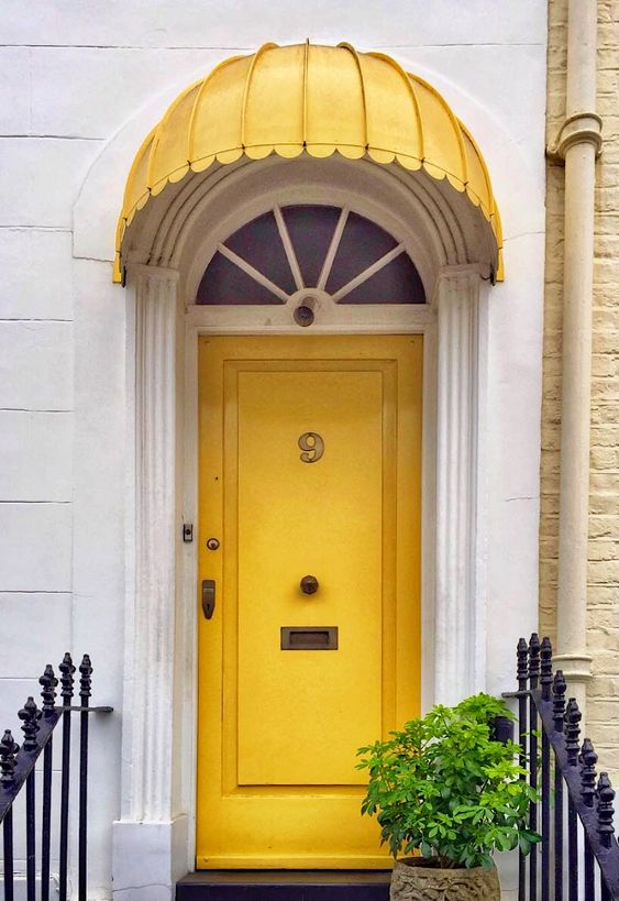 london house-yellow painted front door