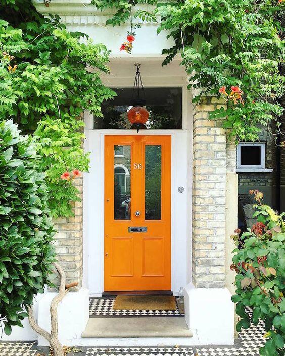 london house-orange painted front door