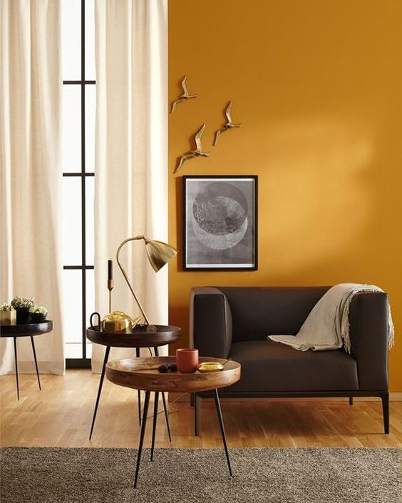 residential painting service for yellow painted living room
