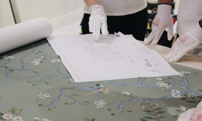 picture o wallpaper hangers preparing to wallpapering
