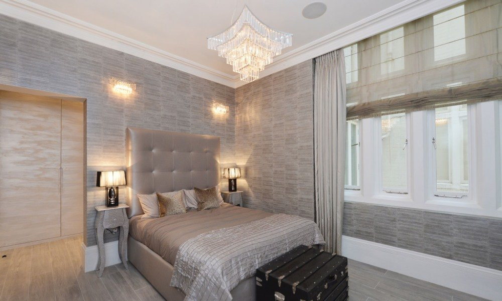 picture of grey fabric wallpaper installed in the bedroom