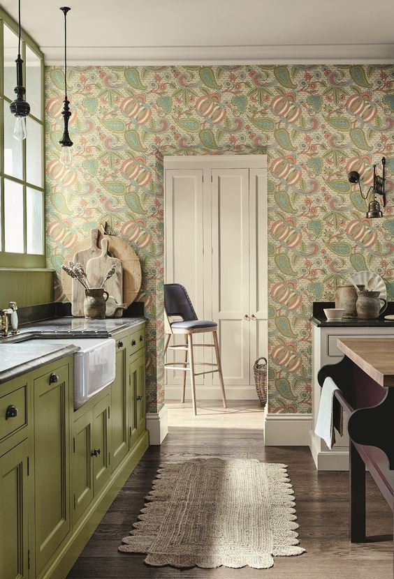 Green painted and wallpapered kitchen