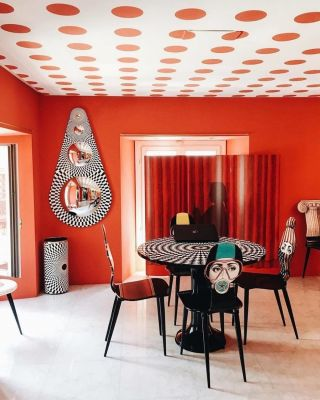 Add geometry to your interior today!  ⠀⠀⠀⠀⠀⠀⠀⠀⠀ Consider decorating with geometry patterns through wallpaper, furniture or artwork.  ⠀⠀⠀⠀⠀⠀⠀⠀⠀ Explore creative painting techniques outside of walls. @fornasetti creates a fun yet daring ceiling through polka dots and complementing the monochromatic pattern through statement pieces.  ⠀⠀⠀⠀⠀⠀⠀⠀⠀ A daring statement we must say! What is your favourite element in this space? . . . . . . . . . . #thegoodpainter #londoninteriordesigner #londonhome #londonproperty #londondesigner #londonpainting #londonapartment #londonhouses #londoninteriordesign #londonpainter #londonpainting #redinspiration #redaesthetic #redwall #boldinteriors #ceilings #ceilingdesign #ceilingdecor  #geoometricdesign #geometricpattern #redinterior #printandpattern #patternlove #patternator  #patternseverywhere #surfacepatterndesign #patternobserver #walltowalldecor #decorhardcore #moreismoredecor